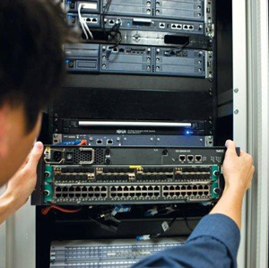 Service tech working on a rack mounted computer